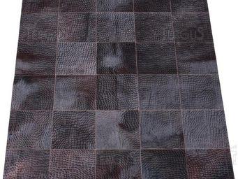 Tergus - motifs press�s - Tapis De Cuir