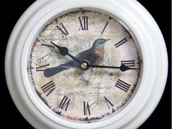 L'HERITIER DU TEMPS - pendule oiseau en fer blanc �21cm - Horloge Murale