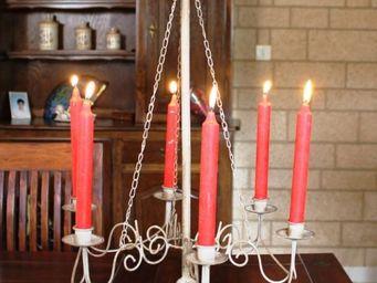 L'HERITIER DU TEMPS - candélabre sur pieds à chaines - Candelabra
