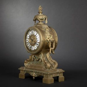 Expertissim - pendule en bronze de style louis xvi - Antique Clock